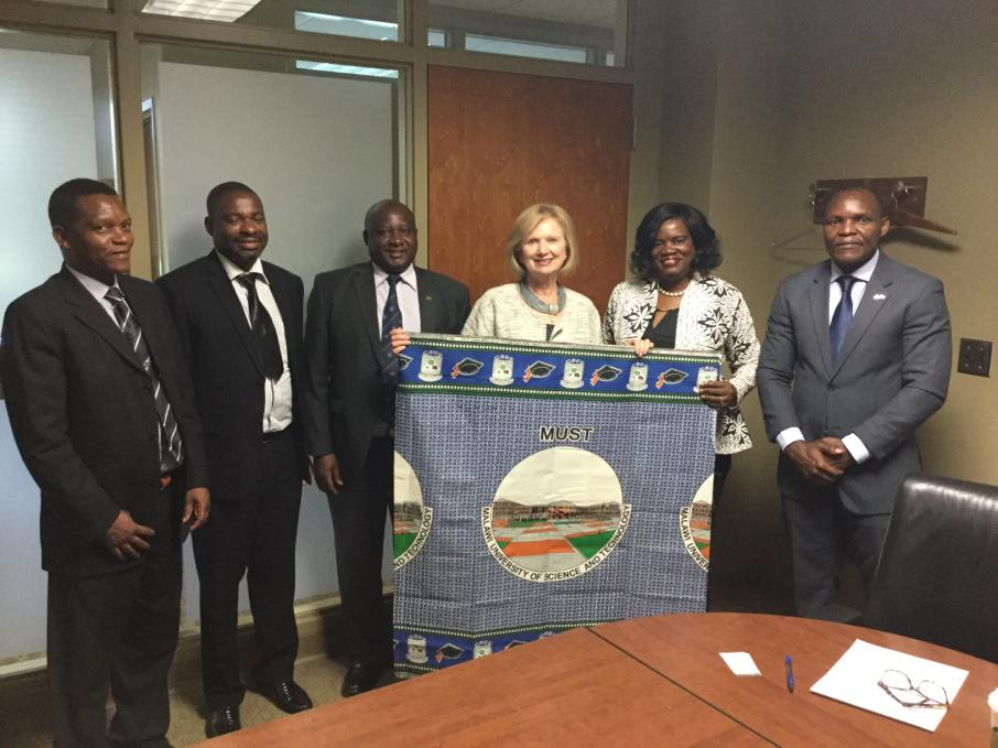 A delegation from MUST poses with MSU Provost June Youatt.